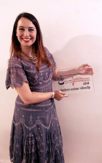 Our director Mariana Conde holding the Best Music Video award